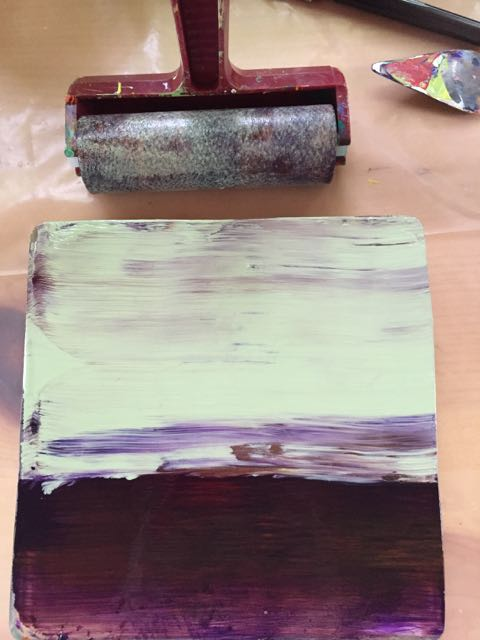 After making photos and drawings of several walls, I cut stencils and foam stamps to use in the printing process. I applied two colors of acrylic paint to a 6x6 inch Gelli Plate with a brayer.
