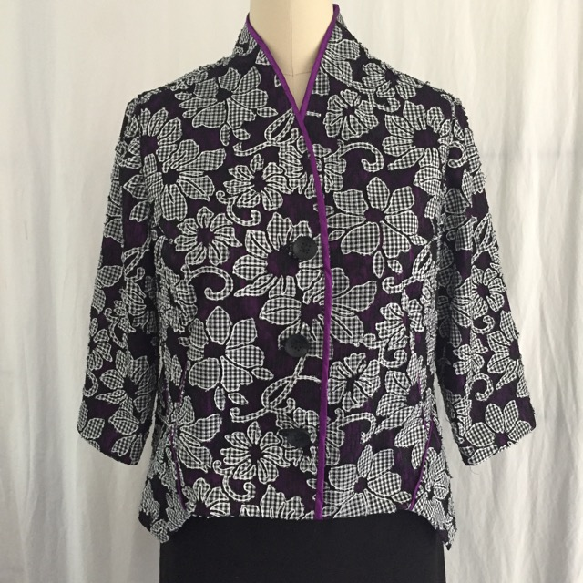 Black and white denim lace with red-purple underling and piping